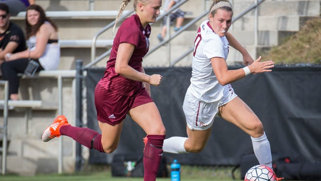 FSU's Kristen McFarland dribbles the ball past a Troy defender during their game on Sunday.
