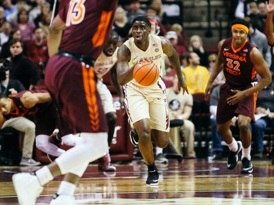 Dwayne Bacon (4) brings the ball up the court during