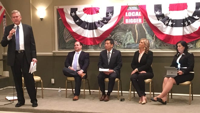 Scott Sayre, chairman of the Sixth Congressional District Republican Committee, introduces candidates (from left to right) Ed Justo, Chan Park, Kathryn Lewis and Cynthia Dunbar, at an event in Natural Bridge, Va., on Wednesday, Jan. 3, 2017. They are all vying for the Republican nomination for 6th Congressional District race in 2018.