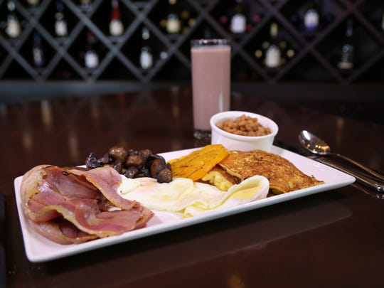 Brunch at Bistro by the Tracks includes this Tennessee English breakfast featuring Benton's country ham, roasted mushrooms, Grainger County tomatoes, Bush's baked beans, house made corn cakes and eggs of choice.