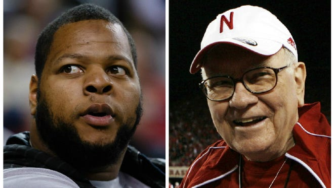"""Miami Dolphins defensive tackle Ndamukong Suh lost an """"arm wrestling"""" match to Nebraska financial power player Warren Buffett on Tuesday."""