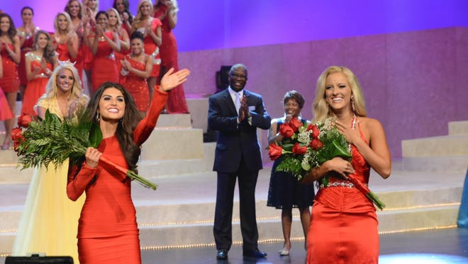 Miss Greene County, Hannah Hausman (left) and Miss Memphis, Madison Snipes (right) express gratitude after being named preliminary winners after the first night of the pageant.