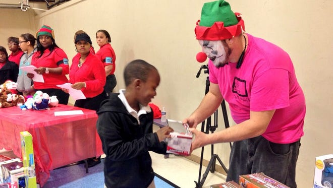 The Rams Community Outreach Program gives Christmas presents to 200 students.