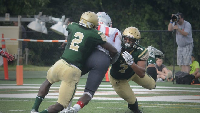 Louis Acceus (2) is among this week's candidates for The Record's Defensive Player of the Year.