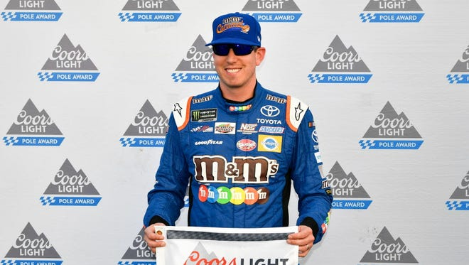 Kyle Busch (18) wins the pole award for the ISM Connect 300 at New Hampshire Motor Speedway.