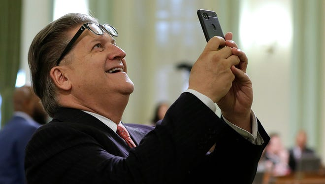 California State Sen. Bob Hertzberg, D-Van Nuys, uses his smartphone to record the Assembly vote data on a data privacy bill during the Assembly floor session, Thursday, June 28, 2018, in Sacramento, Calif. Lawmakers approved the bill that would let consumers ask companies to delete their information or refrain from selling it, among other data privacy provisions. Hertzberg is a joint author of the bill with Assemblyman Ed Chau, D-Arcadia.