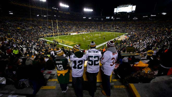 Green Bay Packers and Chicago Bears fans stand and watch from high above the playing field before Sunday night's game at Lambeau Field. The standing-room-only area is higher up in the stadium.
