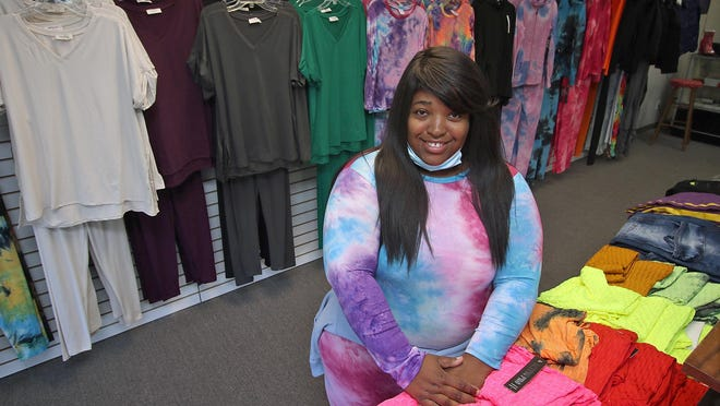 Owner Tiffany Horne poses inside her new shop, Nu Style Fashions, on East Ozark Avenue in Gastonia Thursday afternoon, Nov. 5, 2020.