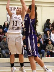 Shania Gililland puts up a shot Thursday night. Tularosa defeated Santa Rosa 75-30.