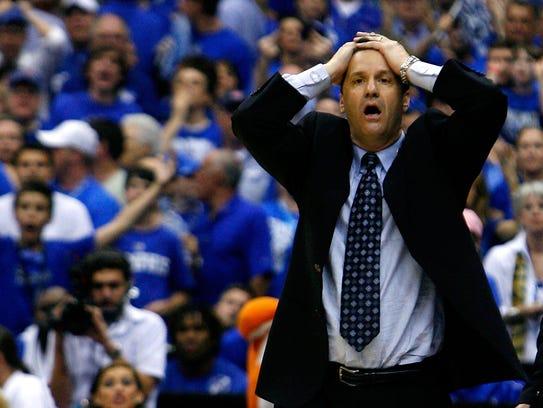 Memphis head coach John Calipari reacts after a foul