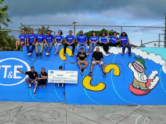 IT&E presented a donation to Opake Guam on July 31 in support of Skate and Create 2018.