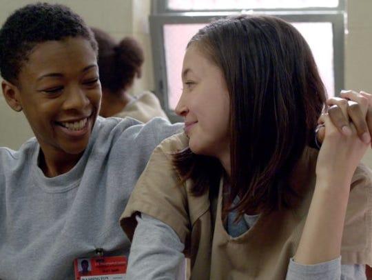 Soso (Kimiko Glenn, right) and Poussey (Samira Wiley)
