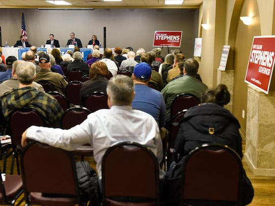 GOP candidates for Minnesota governor Jeff Johnson, Phil Parrish and Mary Giuliani Stephens take turns answering questions Wednesday, April 18, during a candidate debate at the Tuscan Center in Midtown Square.