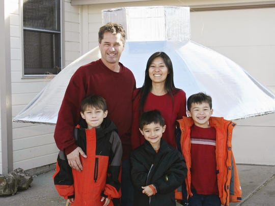 The Heene family, clockwise from back left, Richard, Mayumi, Ryan, Falcon and Bradford are shown at their home in Fort Collins on Nov. 15, 2008.