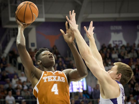 Texas' Mohamed Bamba, left, goes up against Texas Christian's Vladimir Brodziansky in the second half of an NCAA college basketball game  Saturday, Feb. 10, 2018 in Fort Worth, Texas. (Joyce Marshall/Star-Telegram via AP)