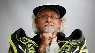 In this Nov. 3, 2017, photo, Don Muchow, of Plano, Tex., displays the multiple pairs of shoes used to complete the annual Capital to Coast Relay. Muchow ran the 223 mile relay by himself. The former Greenwood, Miss., resident is the third person in the race's eight-year history to do so, and the first who is also a Type 1 diabetic.