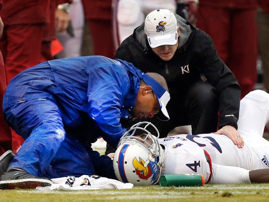 Murphy Grant, left, the head athletic trainer at the