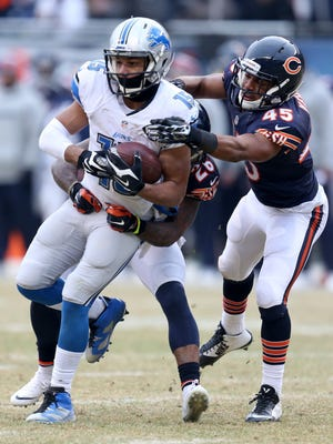 Detroit Lions wide receiver Golden Tate makes the first down catch against the Chicago Bears Tim Jennings and Brock Vereen during second half action Sunday at Soldier Field in Chicago.