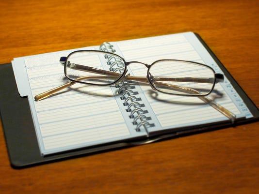 636233711016083338-glasses-on-calendar-1552635-1919x1154-1-.jpg