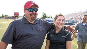 Roncalli assistant lacrosse coach Vinny Romano gives a hug to St. Vincent athletic trainer Sherry Manzelli, before a Rebels home game on May 16.  On April 24, Romano's heart stopped beating in the middle of a game. Manzelli sprung to action to revive him.