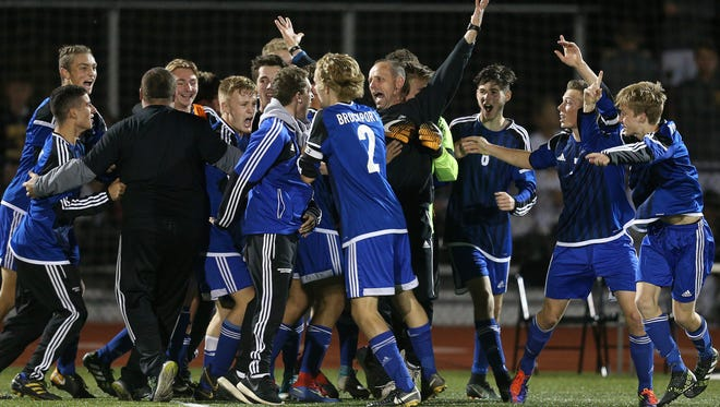 Brockport head coach Chris Zorn celebrates the Blue Devils 2-1 win over Brighton to win the Class A1 championship.  Zorn is retiring at the end of this season.