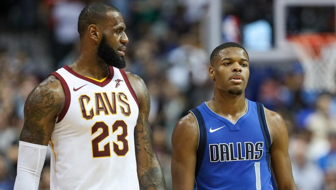 Cleveland Cavaliers forward LeBron James (23) talks to Dallas Mavericks guard Dennis Smith Jr. (1) as they walk up the court during the fourth quarter at American Airlines Center on Saturday, Nov. 11, 2017.