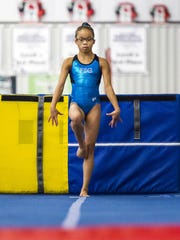 Morgan Hurd practices 30 hours a week at First State Gymnastics.