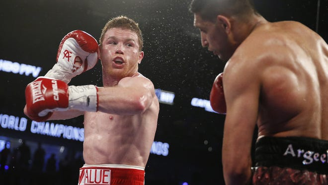 "Saul ""Canelo"" Alvarez, left, will fight Julio Cesar Chavez Jr. on May 6."