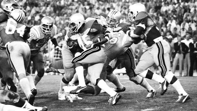 Ohio State running back Archie Griffin picks up 12 yards and a first down against UCLA in a 1975 regular-season game. Ranked No. 1 entering the Rose Bowl, the Buckeyes were upset by the Bruins in a rematch.