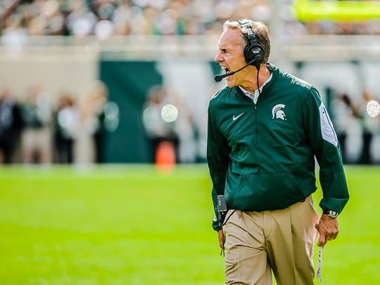 MSU Head Football Coach Mark Dantonio has a few words for the officials when an offside penalty was called against the Spartans late in the 1st quarter.