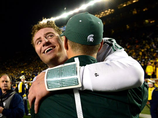 Michigan State quarterback Connor Cook smiles as he