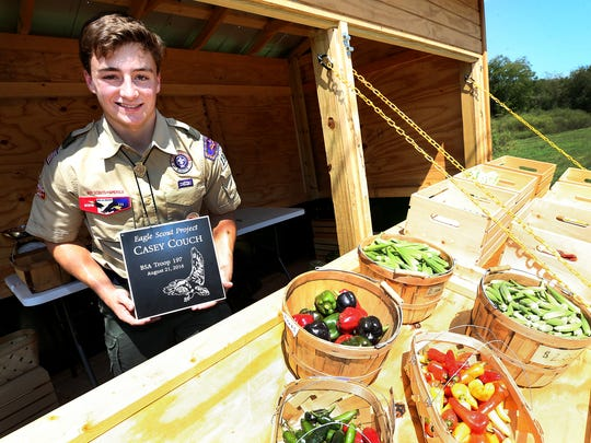 Boy Scout Casey Couch holds his Eagle Scout Project plaque that will be place on the vegetable cart, on Thursday, Sept. 15, 2016, that he built for Journey Home, so that they can sell their fresh vegetables. Couch completed as his Eagle Scout Project.