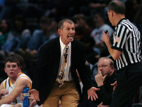 Rocky Mountain coach Bruce Dick pleads with an official during the game with Cherry Creek at the Budweiser Events Center on March 5, 2008.