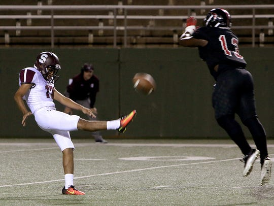 A Sherman punt is nearly blocked by Wichita Falls High's