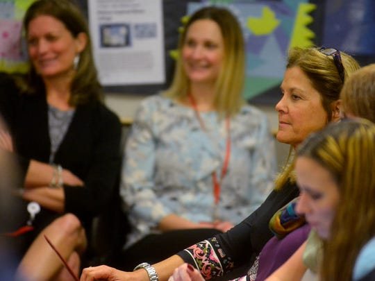 Dr. Patricia Maloney, right, waits for the results of the Dover School Board vote for her to become the District Assistant Superintendent during the meeting, Tuesday, February 20, 2018. Submitted photo