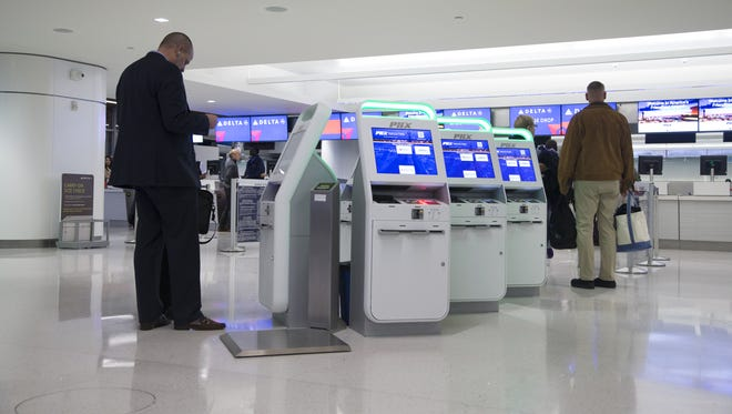 Passengers' check-in at the kiosks at Phoenix Sky Harbor International Airport's Terminal 3, December 6, 2016 in Phoenix.