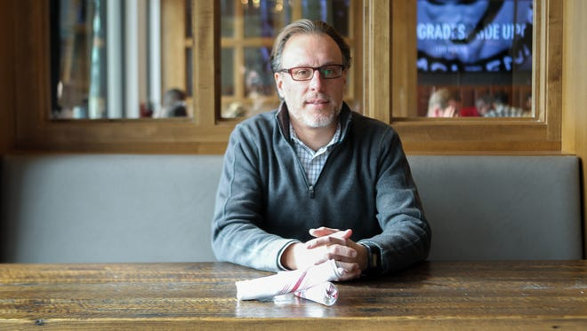 Taste of Belgium owner, Jean-Francois Flechet, sits in his restaurant at the Cincinnati Banks on Thursday Jan 4, 2018.