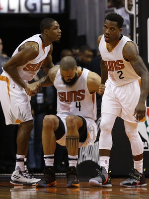 Suns' Tyson Chandler (4) is helped up by Brandon Knight (11) and Eric Bledsoe (2) at Talking Stick Resort Arena on February 10, 2017 in Phoenix, Ariz.
