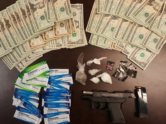 Cash, drugs and a gun the U.S. 23 Major Crimes Task Force reported seizing from 2140 Valley Road on Thursday.