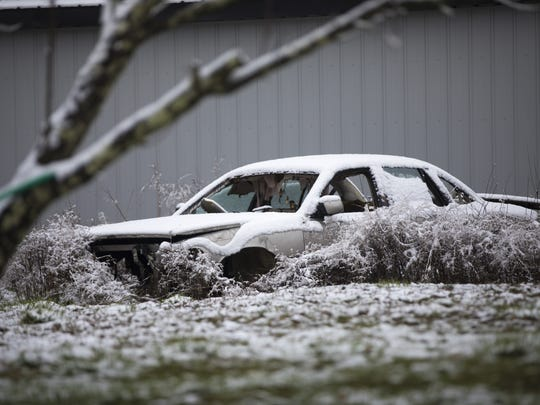 Mon., April 2, 2018: Nearly two years after eight members of a rural Ohio family were killed, snow covers busted out cars on one of the properties where the killings took place. The Enquirer/Carrie Cochran