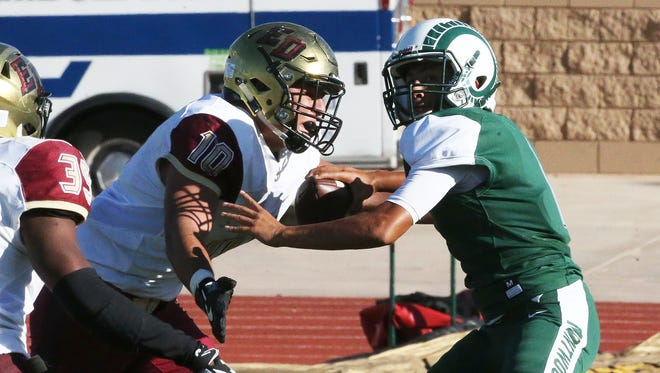 Montwood quarterback Andrew Fernandez, right, is sacked in his own end zone by El Dorado defensive end Jonathan Zarate Thursday.