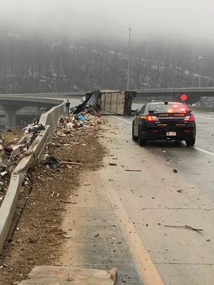 State police respond to an overturned garbage truck on Interstate 81 North in Binghamton.