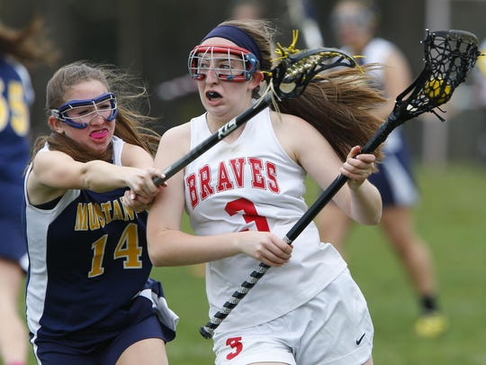 Marlboro's Brooke Franklin (14) defends Manalapan's Erin Rotondo during Friday's game at Manalapan High School.