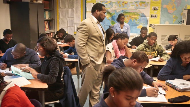 Adofo Muhammad, center, principal of Bedford Academy High School, teaches 10th- and 11th-graders in his Global Studies class in Brooklyn on Dec. 13, 2013.