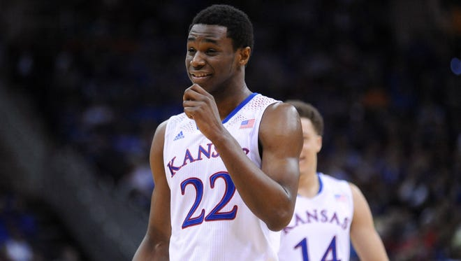 Kansas Jayhawks guard Andrew Wiggins (22) laughs while on the foul line during the second half against the Oklahoma State Cowboys in the second round of the Big 12 Conference college basketball tournament at Sprint Center on March 13, 2014.