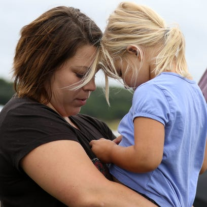 Lisa Grezenski has a moment with her daughter Natalie,