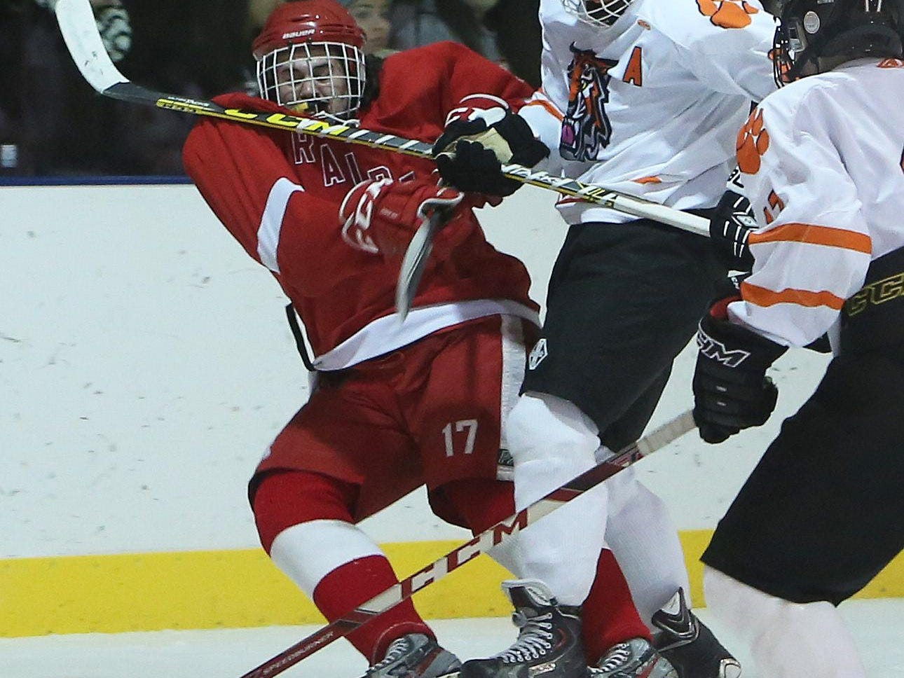 From left, North Rockland's Charles Lowther (17) and White Plains' James Carrier (8) battle for puck control during hockey action at Ebersole Ice Rink in White Plains Jan. 7, 2016. The game ended in a 4-4 tie.