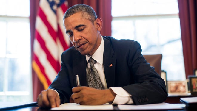 """President Obama vetoes S.J. Res. 8, a resolution disapproving the National Labor Relations Board's so-called """"ambush election"""" rules on March 31, 2015. Obama issued both a pocket veto and a regular veto -- a controversial practice that some say violates the constitution."""