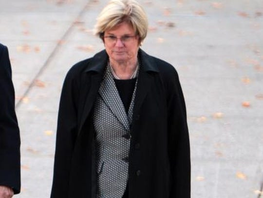 Attorney Linda Pence walking toward the federal courthouse in Indianapolis in 2013.