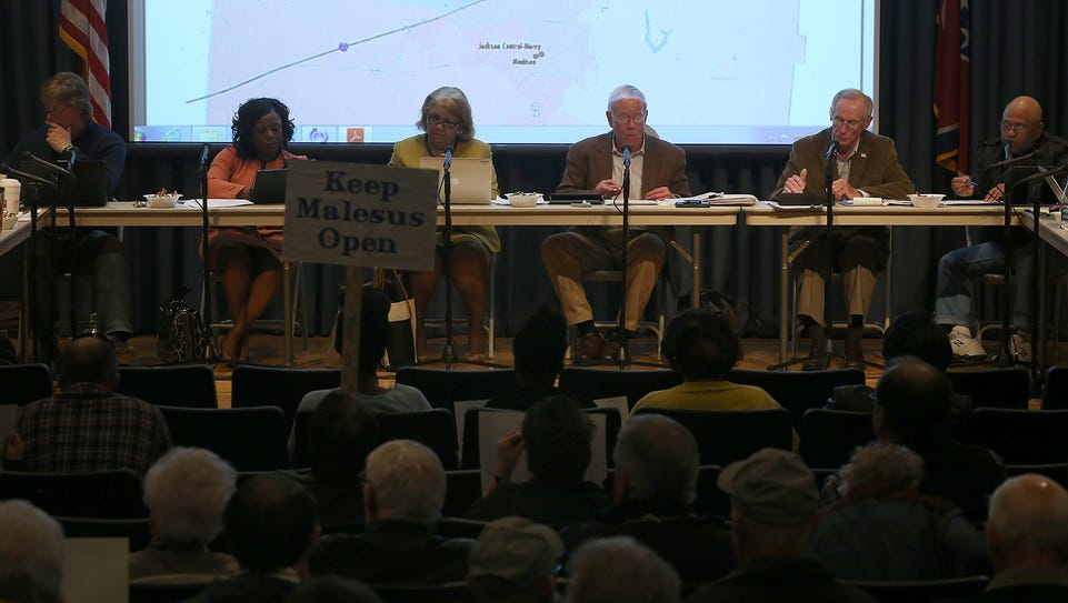 Members of the School Board discuss issues pertaining